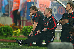 TRABZON, TURKEY - Thursday, August 26, 2010: Liverpool's manager Roy Hodgson and assistant manager Sammy Lee during the UEFA Europa League Play-Off 2nd Leg match against Trabzonspor at the Huseyin Avni Aker Stadium. (Pic by: David Rawcliffe/Propaganda)