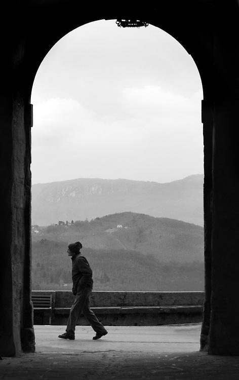Man walking in Castiglione di Garfagnana Italy.