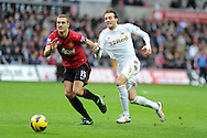 Swansea city's Michu ® goes past Nemanja Vidic of Man Utd.Barclays premier league, Swansea city v Manchester Utd at the Liberty stadium in Swansea, South Wales on Sunday 23rd Dec 2012. pic by Andrew Orchard, Andrew Orchard sports photography,