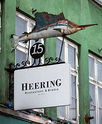 Detail of sign outside bar and restaurant at Nyhavn in Copenhagen Denmark