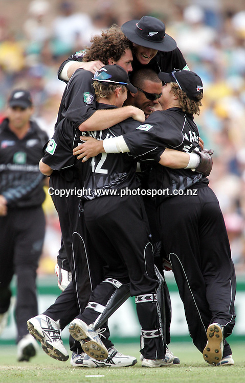 The Black Caps congratulate Kyle Mills on one of his two wickets during game two of the Chappell-Hadlee Trophy between Australia and New Zealand played at the Sydney Cricket Ground December 8, 2004 in Sydney, Australia. <br />PHOTO: Andrew Cornaga / PHOTOSPORT