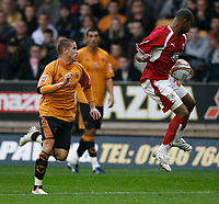 Photo: Steve Bond/Sportsbeat Images.<br /> Wolverhampton Wanderers v Bristol City. Coca Cola Championship. 03/11/2007. Marvin Elliott (R) controls the ball in front of Michael Kightly (L)