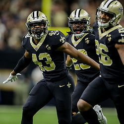 Nov 4, 2018; New Orleans, LA, USA; New Orleans Saints free safety Marcus Williams (43) and cornerback Marshon Lattimore (23) and cornerback P.J. Williams (26) celebrate after a turnover on down by the Los Angeles Rams during the fourth quarter at the Mercedes-Benz Superdome. Mandatory Credit: Derick E. Hingle-USA TODAY Sports
