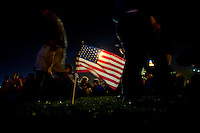 A American flag is illuminated in a overflow area as supporters take to Chicago's Grant Park for the election night results for the presidential race between Sen. Barak Obama (D-IL) and Sen. John McCain (R-AZ) Tuesday Nov. 4, 2008 Chicago IL.