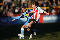 Danny Senda left for Wycombe, Brian Wilson right for Cheltenham<br /> <br /> Photo: Richard Eaton.<br /> <br /> Cheltenham Town v Wycombe Wanderers. Coca Cola League 2. 04/03/2006.