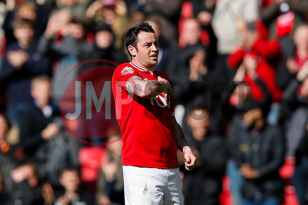 Lee Tomlin of Bristol City pats the crest and thanks the fans after scoring a goal to make it 4-0 in the last home game of the season - Mandatory byline: Rogan Thomson/JMP - 30/04/2016 - FOOTBALL - Ashton Gate Stadium - Bristol, England - Bristol City v Huddersfield Town - Sky Bet Championship.