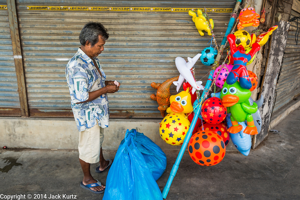 29 JULY 2014 - HAT YAI, SONGKHLA, THAILAND:  An inflatable toy vendor in the market in Hat Yai, Thailand. Hat Yai is the 4th largest city in Thailand and the largest outside of the Bangkok metropolitan area. It's less the 50 miles from the Malaysian border and is a popular vacation spot for Malaysian and Singaporean tourists.       PHOTO BY JACK KURTZ