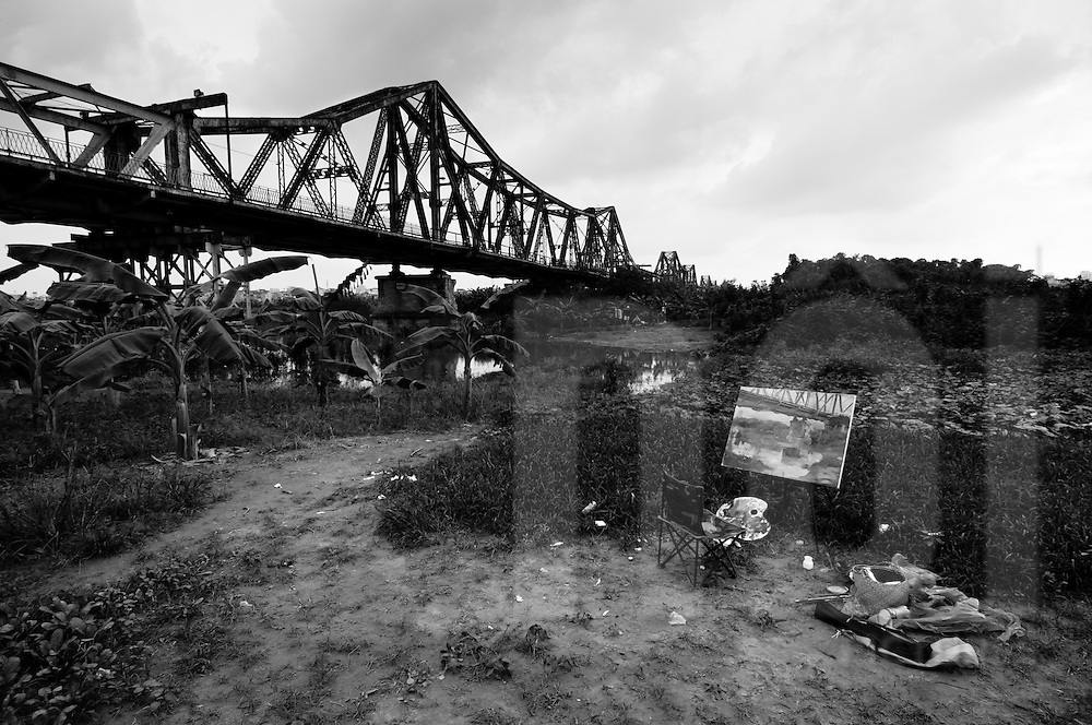 "Long Bien Bridge as viewed from the ""middle warp"" island, where an artist has been painting the bridge, Hanoi, Vietnam, Southeast Asia"