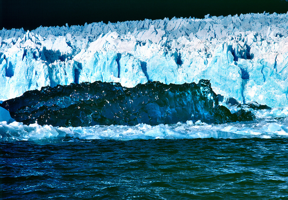 An new iceberg turns over, revealing its glassy underside in San Rafael Lagoon NP, Chile.
