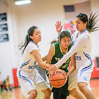 Window Rock Scouts D'ovionn Wagner (21), left, and Jennifer Angeles (22) trap Thoreau Hawk Nicola Casamero (24) at the Grants Invitational girls basketball tournament at Grants High School Friday.