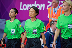 COVENTRY, ENGLAND - Friday, August 3, 2012: Referee Sachiko Yamagishi (C) and her assistants before the Women's Football Quarter-Final match between Great Britain and Canada, on Day 7 of the London 2012 Olympic Games at the Rioch Arena. Canada won 2-0. (Photo by David Rawcliffe/Propaganda)