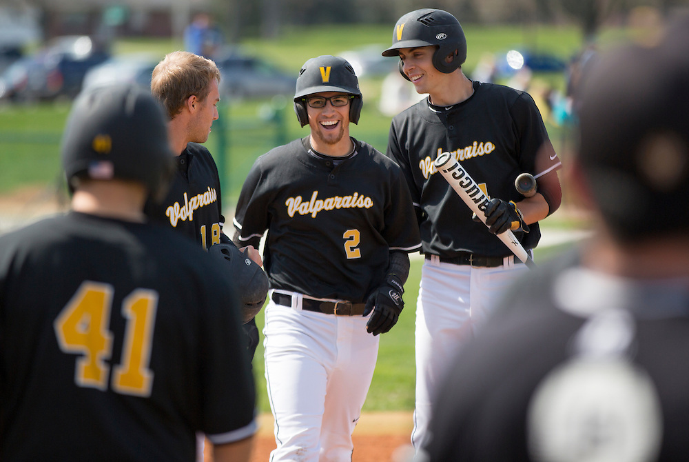 Valparaiso University junior outfielder Chris Manning, 2, is congratulated after his first-inning home-run versus Wright State at Emory Bauer Field Friday, April 26, 2013.