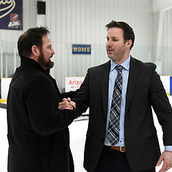 TORONTO, ON  - APR 10,  2018: Ontario Junior Hockey League, South West Conference Championship Series. Game seven of the best of seven series between Georgetown Raiders and the Toronto Patriots. Greg Walters Head Coach of the Georgetown Raiders and John Dean Head Coach of the Toronto Patriots after the final buzzer of the South West Conference.<br /> (Photo by Andy Corneau / OJHL Images)