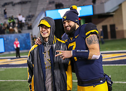 Oct 25, 2018; Morgantown, WV, USA; West Virginia Mountaineers quarterback Will Grier (7) celebrates with his brother Nash Grier after beating the Baylor Bears at Mountaineer Field at Milan Puskar Stadium. Mandatory Credit: Ben Queen-USA TODAY Sports