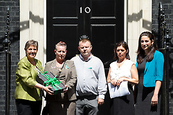 © Licensed to London News Pictures. 16/07/2013. London, UK. Julie Hilling, MP for Bolton West (L), Shirley (2L) and Michael Anderson (3L), the parents of Jade Anderson, who was mauled to death by dogs, Angela McGlynn (2R), the mother of a four-year-old John Paul Massey who was killed by a dog and Luciana Berger, the Member of Parliament for Liverpool Wavertree stand on the steps of Number 10 before handing in a petition calling on the Government to take more action on dangerous dogs on Downing Street in London today (16/07/2013). Photo credit: Matt Cetti-Roberts/LNP