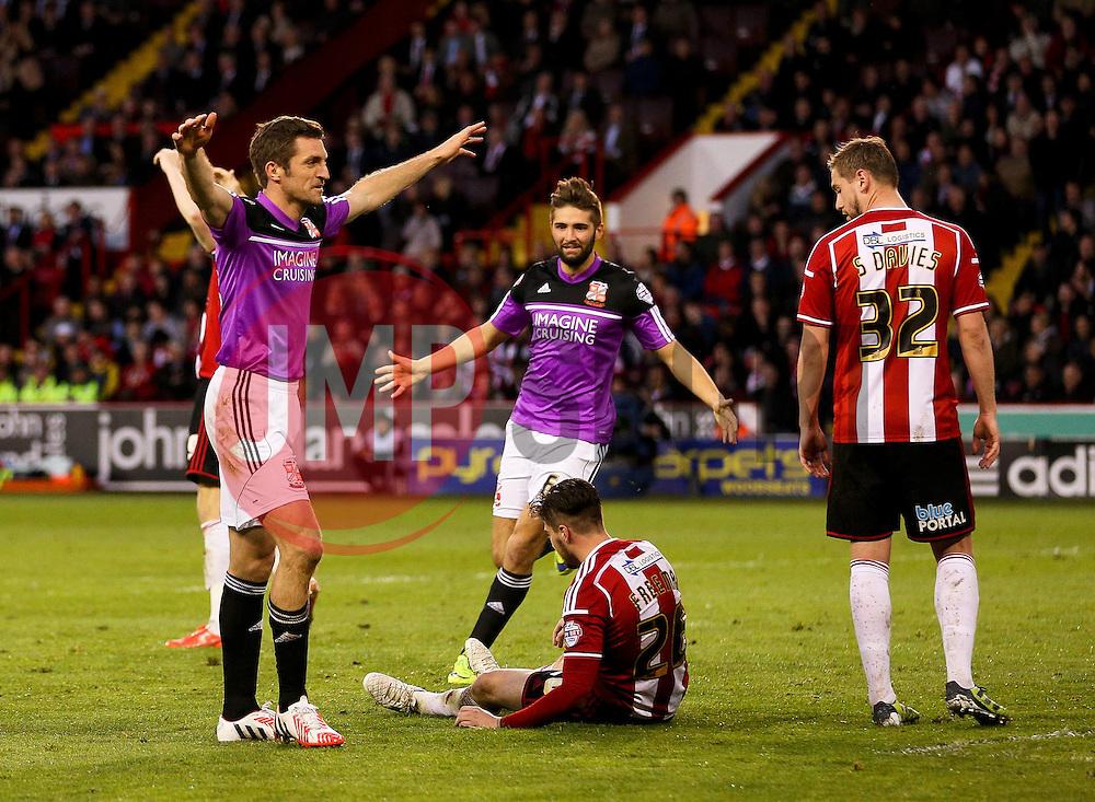 Sam Ricketts of Swindon Town celebrates after scoring the equaliser to make it 1-1 - Photo mandatory by-line: Matt McNulty/JMP - Mobile: 07966 386802 - 07/05/2015 - SPORT - Football - Sheffield - Bramall Lane - Sheffield United v Swindon Town - Sky Bet League One