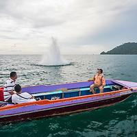 A fish bomb explodes in the water, Kota Kinabalu, Borneo, Malaysia, South China Sea,