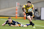 Nehe Milner-Skudder in space after beating a defender during the Super Rugby match, Brumbies V Hurricanes, GIO Stadium, Canberra, Australia, 30th June 2018.Copyright photo: David Neilson / www.photosport.nz