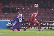 York City forward Vadaine Oliver skips past Doncaster Rovers goalkeeper Thorsten Stuckmann  to score his second goal during the Johnstone's Paint Trophy match between York City and Doncaster Rovers at Bootham Crescent, York, England on 6 October 2015. Photo by Simon Davies.