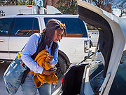 """13 MARCH 2020 - DES MOINES, IOWA: MYIA SIMS, a student at Drake University, walks to her car without her suitcase before going home for spring break. The Governor of Iowa announced Friday that 17 people in Iowa have tested positive for the Novel Coronavirus. Of those, 15 people were exposed on the same cruise in Egypt, the others were exposed through travel but were not on the same cruise. The Governor said there has not yet been any """"community spread"""" in Iowa. All of the Iowans who have tested positive are in self quarantine. Across Iowa, municipalities and businesses are taking steps to implement """"social distancing."""" Most of the colleges in Iowa, including Drake University, have announced that they will remain closed after their spring breaks and that classes will move to online only, after spring break. Many businesses in Des Moines, including Nationwide Insurance and EMC Insurance, have announced plans to have their employees to telecommute. The mayor of Des Moines has urged event planners to consider canceling large events.     PHOTO BY JACK KURTZ"""