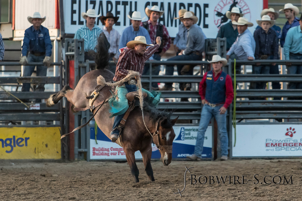 Saddle bronc rider Garrett Buckley rides Summit Pro Rodeo's Chugwater Chili in the second performance of the Elizabeth Stampede on Saturday, June 2, 2018.