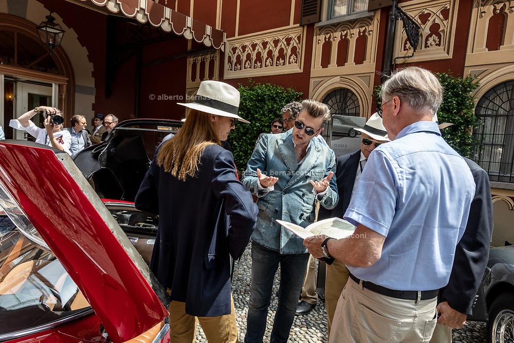 Como, Italy, Concorso d'Eleganza Villa D'Este, Alfa Romeo 33/2 Stradale, talking about the specs of the car with part of the jury