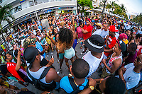 MIAMI BEACH - MAY 25: Crowd having fun and dacing in the streets during the Urban Beach Weekend, on May 25, 2013 in Miami Beach. This is the largest Urban Festival in the World, that caters towards the Hip Hop Generation. Over 300.000 participants make the annual trek to South Beach for 4 days full of fun, food, festivities, entertainment, music, and more.