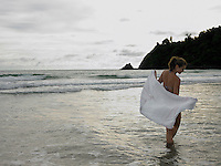 Young Woman Wading in Ocean