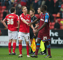 LONDON, ENGLAND - Saturday, March 5, 2011: Tranmere Rovers' Zoumana Bakayogo shakes hands with Charlton Athletic's Scott Wagstaff after their 1-1 draw during the Football League One match at The Valley. (Photo by Gareth Davies/Propaganda)