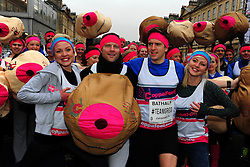 © Licensed to London News Pictures. 19/02/2013.Bristol, City of Bristol. Dermot O'Leary and Greg James with Kris and Maren Hallenga from CoppaFeel and girls from 'Hooters' and the CoppaFeel! Breast cancer charity at the start of the Bath Half Marathon.. Photo credit : Jon Kent/LNP