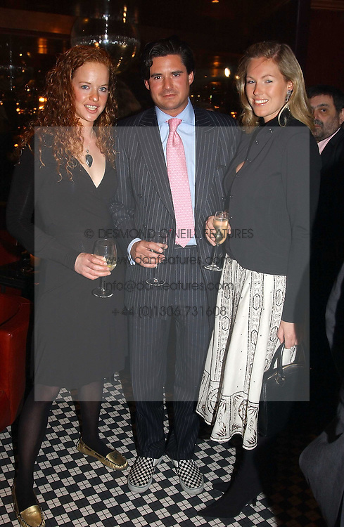 Left to right, ALICIA FOX-PITT, EDWARD TAYLOR and MARINA HUNT at a party to celebrate the launch of Ladies' Day at The Vodafone Derby Festival held at Frankie's Bar & Grill, 3 Yeomans Row, London SW7 on 19th April 2005.<br />