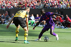 July 22, 2018 - Charlotte, NC, U.S. - CHARLOTTE, NC - JULY 22: Liverpool midfielder Naby Keita (8)  with the ball while Borussia Dortmund midfielder Junior Flores (42) goes after him during the 2nd half of the International Champions Cup match between Liverpool FC and Borussia Dortmund on July 22, 2018 at Bank of America Stadium in Charlotte, NC.(Photo by Jaylynn Nash/Icon Sportswire) (Credit Image: © Jaylynn Nash/Icon SMI via ZUMA Press)