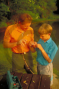 Outdoor recreation, Fishing Father and Son Catch Fish,