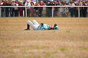 2  April, 2011:  Jockey William Dowling lies in the grass after his horse,  WORRIED MAN went through a wing on the final fence in the Camden Plate Maiden Hurdle.