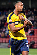 Tyrone Barnett celebrates during the Sky Bet League 2 match between Cheltenham Town and Oxford United at Whaddon Road, Cheltenham, England on 29 November 2014.