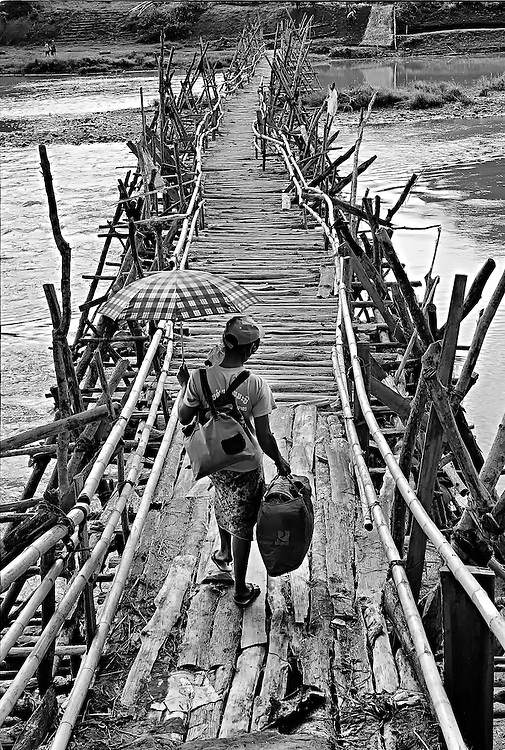 Crossing the Nam Khan (river) over a bamboo bridge near luang Prabang, Laos.