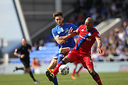 Ollie Banks challenges Calvin Andrew during the EFL Sky Bet League 1 match between Oldham Athletic and Rochdale at Boundary Park, Oldham, England on 22 April 2017. Photo by Daniel Youngs.