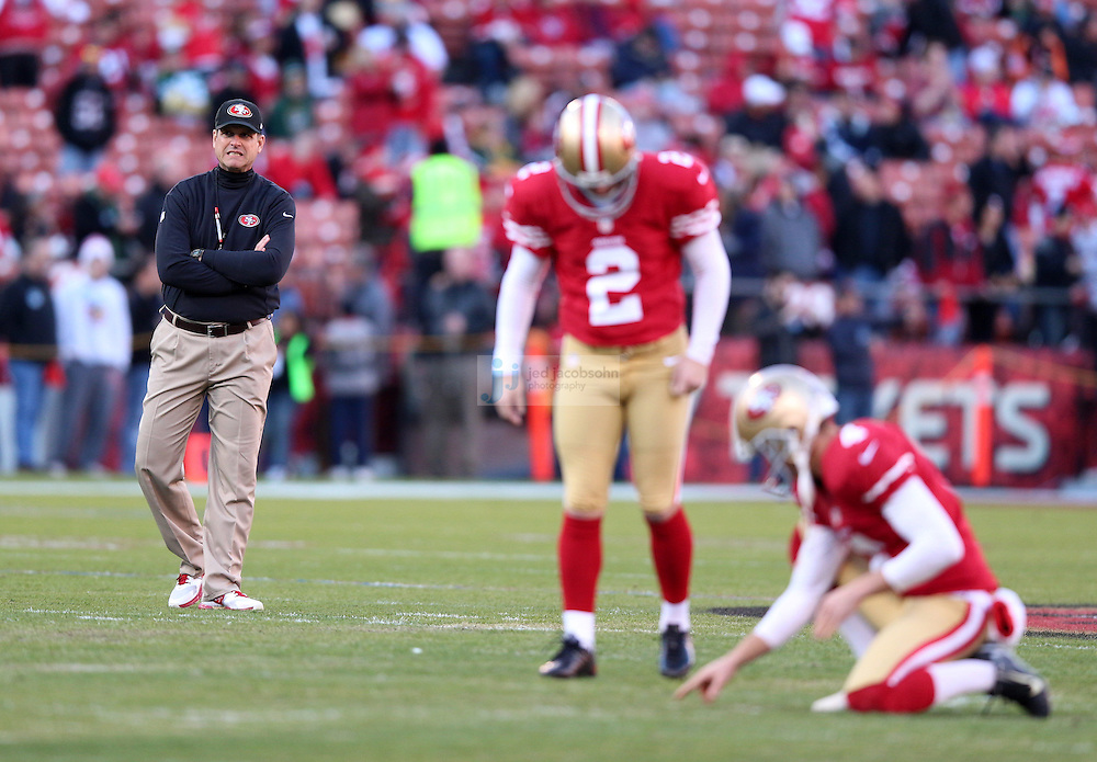 Head coach Jim Harbaugh looks on during a NFL Divisional playoff game against the Green Bay Packers and the San Francisco 49ers at Candlestick Park in San Francisco, Calif., on Jan. 12, 2013. The 49ers defeated the Packers 45-31. (AP Photo/Jed Jacobsohn)