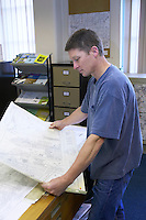 man studying a detailed map of his local area