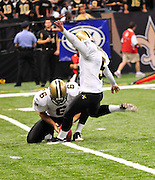New Orlenas Sainst (k) kicker Garrett Hartley (5) kicks a field  goal to tie the game and seend it to OT against the Atlanta Falcons, then misses a field goal in OT and teh Falcons went on to win 27-24.The Super Bowl Champions New Orleans Saints play the Atlanta Falcons Sunday Sept 26, 2010 in New Orleans at the Super Dome in Louisiana.  The Saints and Falcons are tied at half time and went into overtime tied 24-24. Hartley missed a kick to win in overtime., the Atlanta Falcons went on to win on OT with a field goal 27-24. PHOTO©SuziAltman.com