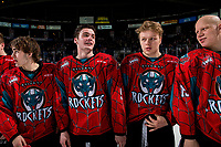 KELOWNA, CANADA - MARCH 16: Mark Liwiski #9 Ted Brennan #10 and Dallon Wilton #15 of the Kelowna Rockets line up for the shirt off your back presentation after the OT win against the Vancouver Giants  on March 16, 2019 at Prospera Place in Kelowna, British Columbia, Canada.  (Photo by Marissa Baecker/Shoot the Breeze)