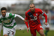 York City midfielder Russell Penn  and Yeovil Town midfielder, on loan from Swansea City, Josh Sheehan  during the Sky Bet League 2 match between Yeovil Town and York City at Huish Park, Yeovil, England on 2 January 2016. Photo by Simon Davies.