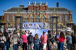 © Licensed to London News Pictures. 31/08/2017. London, UK. Members of the public gather to look at flowers and tributes left at the gates to Kensington Palace in London on the 20th anniversary of the death of Diana, Princess of Wales. Princess Diana was fatally injured in a car crash along with her companion Dodi Fayed, while the couple were being driven through the Pont de l'Alma tunnel in Paris on 31 August 1997. Photo credit: Ben Cawthra/LNP