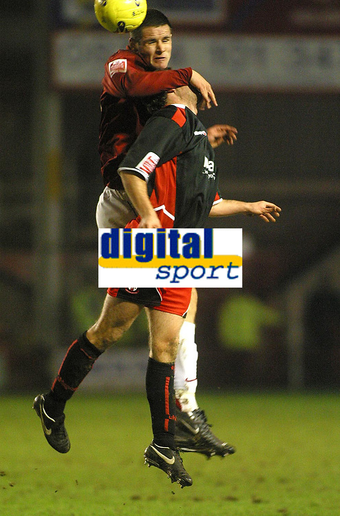 Photo: Dave Linney.<br />Walsall v Lincoln City. Coca Cola League 2. 16/02/2007.<br />Walsall's Scott Dann(L) gets the better of   Lee Beavers.