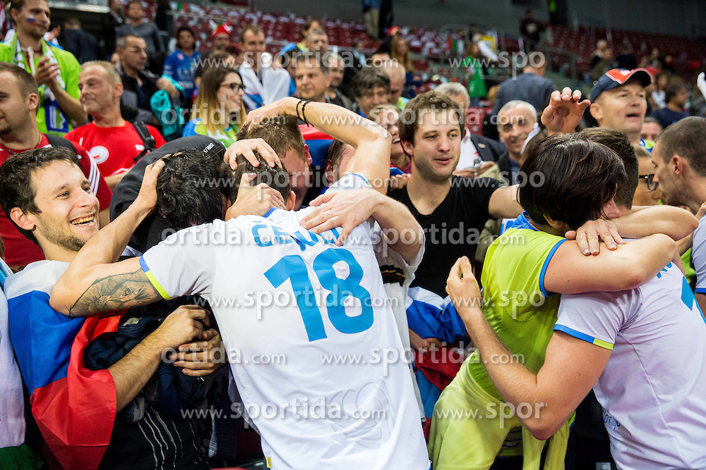 Klemen Cebulj #18 of Slovenia and Gregor Ropret #16 of Slovenia with fans celebrate after winning during volleyball match between National teams of Slovenia and Italy in 1st Semifinal of 2015 CEV Volleyball European Championship - Men, on October 17, 2015 in Arena Armeec, Sofia, Bulgaria. Photo by Vid Ponikvar / Sportida