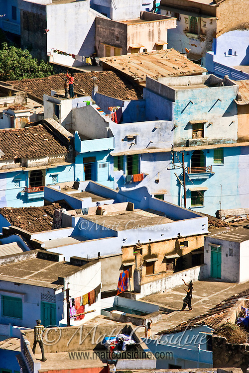 Children flying kites from the rooftops in a village in Rajasthan.<br /> (Photo by Matt Considine - Images of Asia Collection)