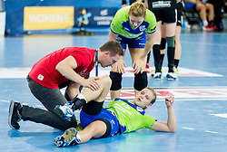 Physiotherapist Andrej Potrata and injured Barbara Lazovic-Varlec #15 of RK Krim Mercator during handball match between RK Krim Mercator (SLO) and HC Leipzig (GER) in 6th Round of Women's Champions League on November 16, 2013 in Arena Stozice, Ljubljana, Slovenia.  Photo by Vid Ponikvar / Sportida