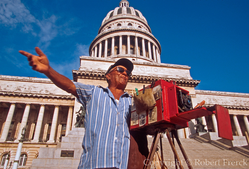 CUBA, HAVANA (CENTRO HABANA) Capitolio Nacional, modeled after the U.S. Capitol Building and street  photographer with antique camera