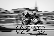 Picture by Andrew Tobin/Tobinators Ltd +44 7710 761829<br /> 04/08/2013<br /> A tendem courier unit in action during the Cycle Messenger World Championships held in Lausanne, Switzerland. Started in 1993 by Achim Beier from Berlin, the championships are not only a sporting contest but an opportunity to unite friends and bicycle enthusiasts worldwide. The event comprises a number of challenges including a sprint, a track stand (longest time stationary on the bike), a cargo race where heavy loads are carried on special bikes, and the main race. The course winds through central Lausanne and includes bridges, stairs, cobbles, narrow alleyways and challenging hills. The main race simulates the job of a bike courier making numerous drops and pickups across the city. Riders need to check in at specific checkpoints, hand over their delivery and get a new one. The main race can take up to 4 hours for each competitor to complete.