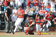 Mississippi's Aaron Greenwood (44) claps as he scores the game winning run behind Texas Tech's Hunter Redman (5) in the bottom of the 9th inning at T.D. Ameritrade Park in the College World Series in Omaha, Neb. on Tuesday, June 17, 2014. Ole Miss won 2-1.